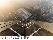 Купить «SHENZHEN, CHINA - AUG 26, 2015: Building wall and morning city in fog, view from Ping An Finance Centre», фото № 28212489, снято 26 августа 2015 г. (c) Losevsky Pavel / Фотобанк Лори