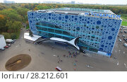 Купить «MOSCOW - SEP 22, 2015: Mosquarium the center of oceanography and sea biology in Exhibition of National Achievements at autumn sunny day. Aerial view videoframe», фото № 28212601, снято 22 сентября 2015 г. (c) Losevsky Pavel / Фотобанк Лори
