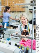 Купить «Two concentrated women tailors different ages working with sewing machines», фото № 28213097, снято 12 декабря 2018 г. (c) Яков Филимонов / Фотобанк Лори