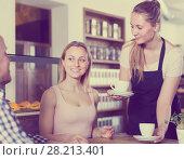 Купить «waiter girl brought cup of coffee for couple of different aged cheerful people», фото № 28213401, снято 22 апреля 2017 г. (c) Яков Филимонов / Фотобанк Лори