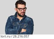 Купить «confident male model has black beard and mustache», фото № 28216057, снято 25 февраля 2018 г. (c) Александр Лычагин / Фотобанк Лори