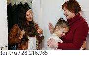 Купить «Smiling young mother leaving daughter in tears with grandma at home, saying goodbye», видеоролик № 28216985, снято 27 ноября 2017 г. (c) Яков Филимонов / Фотобанк Лори
