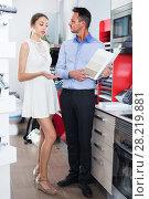 Купить «Adult husband and wife are choosing material for countertop», фото № 28219881, снято 15 июня 2017 г. (c) Яков Филимонов / Фотобанк Лори