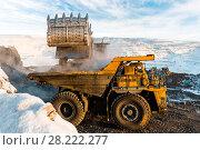 Купить «Large quarry dump truck. Loading the rock in dumper. Loading coal into body truck. Production useful minerals. Mining truck mining machinery, to transport coal from open-pit as the Coal Production.», фото № 28222277, снято 30 января 2018 г. (c) Сергей Тимофеев / Фотобанк Лори