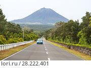 Купить «Blue car on the highway on the background of the volcano Pico, Azores», фото № 28222401, снято 5 мая 2012 г. (c) Юлия Бабкина / Фотобанк Лори