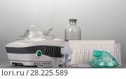 Compressor nebulizer for adults and children, spare vials of medicine on grey. Стоковое фото, фотограф Сергей Молодиков / Фотобанк Лори