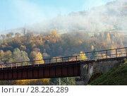 Купить «Autumn Carpathian mountains and railroad bridge, Ukraine», фото № 28226289, снято 18 октября 2017 г. (c) Юрий Брыкайло / Фотобанк Лори