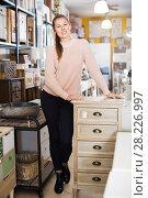 Купить «Female choosing commode in store», фото № 28226997, снято 15 ноября 2017 г. (c) Яков Филимонов / Фотобанк Лори