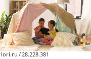 Купить «little girls with tablet pc in kids tent at home», видеоролик № 28228381, снято 23 февраля 2018 г. (c) Syda Productions / Фотобанк Лори