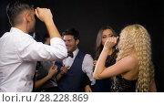 Купить «happy friends dancing at party or disco», видеоролик № 28228869, снято 7 марта 2018 г. (c) Syda Productions / Фотобанк Лори