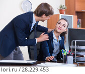 Купить «Top manager flirting with subordinate official at workplace», фото № 28229453, снято 5 декабря 2019 г. (c) Яков Филимонов / Фотобанк Лори