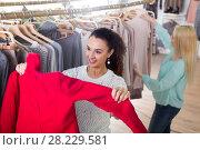 Купить «Young women at the apparel store», фото № 28229581, снято 20 октября 2018 г. (c) Яков Филимонов / Фотобанк Лори