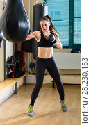 Купить «Strong woman in time of workout at boxer club», фото № 28230153, снято 21 марта 2018 г. (c) Владимир Мельников / Фотобанк Лори