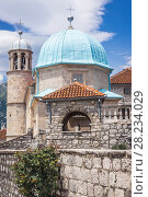 Купить «Small church on Our Lady of the Rocks Island, one of the two islets of the coast of Perast town in the Bay of Kotor, Montenegro.», фото № 28234029, снято 26 мая 2017 г. (c) easy Fotostock / Фотобанк Лори