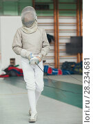 Купить «Young fencer in special costume at the fencing competition with rapier», фото № 28234681, снято 26 марта 2018 г. (c) Константин Шишкин / Фотобанк Лори