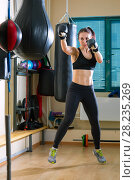 Купить «Strong woman in time of workout at boxer club», фото № 28235269, снято 21 марта 2018 г. (c) Владимир Мельников / Фотобанк Лори