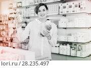 Купить «Female customer looking for products», фото № 28235497, снято 31 января 2017 г. (c) Яков Филимонов / Фотобанк Лори