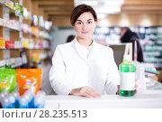 Купить «Pharmacist ready to assist in choosing at counter», фото № 28235513, снято 31 января 2017 г. (c) Яков Филимонов / Фотобанк Лори