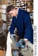 Купить «male worker processing plank in machine at workshop», фото № 28235785, снято 7 ноября 2016 г. (c) Яков Филимонов / Фотобанк Лори
