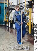 Купить «Smiling old woman cleaner in workwear on manufacturing site», фото № 28239285, снято 24 марта 2018 г. (c) Константин Шишкин / Фотобанк Лори
