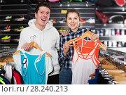 Купить «Couple demonstraiting new sportwear», фото № 28240213, снято 7 февраля 2018 г. (c) Яков Филимонов / Фотобанк Лори