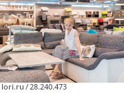 Купить «Woman shopping for new sofa in furniture store.», фото № 28240473, снято 21 августа 2019 г. (c) Matej Kastelic / Фотобанк Лори