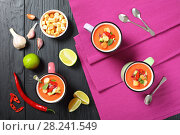 Купить «portions of delicious gazpacho in cups», фото № 28241549, снято 19 марта 2018 г. (c) Oksana Zh / Фотобанк Лори