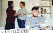 Young upset man during quarrel with wife and her mother at home. Стоковое видео, видеограф Яков Филимонов / Фотобанк Лори