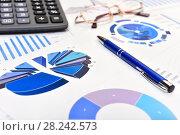 Купить «Графики, диаграммы, калькулятор и ручка. Бизнес-натюрморт», эксклюзивное фото № 28242573, снято 30 марта 2018 г. (c) Юрий Морозов / Фотобанк Лори