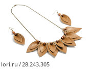 Купить «Unique pendant and earrings consisting of petals of brown leather on a white background», фото № 28243305, снято 21 марта 2018 г. (c) Олег Белов / Фотобанк Лори