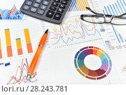 Купить «Калькулятор, графики, диаграммы, очки и ручка. Бизнес-натюрморт», эксклюзивное фото № 28243781, снято 30 марта 2018 г. (c) Юрий Морозов / Фотобанк Лори