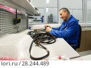 Купить «Electric solder wires to the electrical connector.», фото № 28244489, снято 19 октября 2017 г. (c) Андрей Радченко / Фотобанк Лори