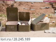 Купить «Пустые коробки от боеприпасов для российского автоматического гранатомета, военный полигон Алабино», фото № 28245189, снято 24 августа 2017 г. (c) Малышев Андрей / Фотобанк Лори