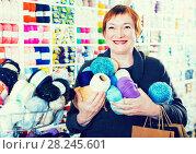 Купить «Woman holding shopping bags and accessories for knitting and embroidery», фото № 28245601, снято 10 мая 2017 г. (c) Яков Филимонов / Фотобанк Лори