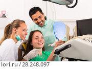 Купить «Contented patient in dental clinic», фото № 28248097, снято 19 марта 2019 г. (c) Яков Филимонов / Фотобанк Лори