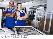 Portrait of two smiling professional workers in assembly shop. Стоковое фото, фотограф Яков Филимонов / Фотобанк Лори