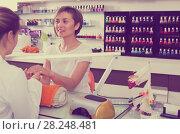 Купить «Manicure masters working», фото № 28248481, снято 28 апреля 2017 г. (c) Яков Филимонов / Фотобанк Лори