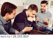 Купить «Three anxious men discussing on sofa», фото № 28255869, снято 10 января 2018 г. (c) Яков Филимонов / Фотобанк Лори