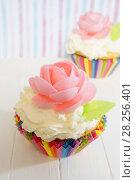 Купить «Cupcake decorated with a rose. Homemade cake with cream and waffles. Striped background.», фото № 28256401, снято 3 апреля 2018 г. (c) ирина реброва / Фотобанк Лори
