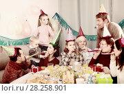 Купить «family having fun during children's birthday party», фото № 28258901, снято 25 мая 2018 г. (c) Яков Филимонов / Фотобанк Лори