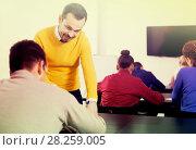 Купить «Male teacher clearing up complicated issue to pupil during exam in class», фото № 28259005, снято 28 февраля 2017 г. (c) Яков Филимонов / Фотобанк Лори