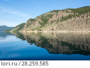 Купить «West coast of Lake Baikal with reflection of coastline with forest, Siberia, Russia.», фото № 28259585, снято 23 апреля 2019 г. (c) Nature Picture Library / Фотобанк Лори