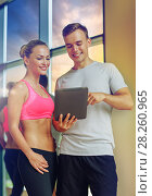 Купить «smiling young woman with personal trainer in gym», фото № 28260965, снято 29 июня 2014 г. (c) Syda Productions / Фотобанк Лори