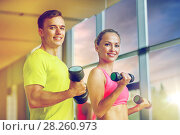 Купить «smiling man and woman with dumbbells in gym», фото № 28260973, снято 29 июня 2014 г. (c) Syda Productions / Фотобанк Лори
