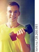 Купить «smiling man with dumbbell in gym», фото № 28260981, снято 29 июня 2014 г. (c) Syda Productions / Фотобанк Лори