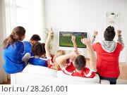 Купить «football fans watching soccer game on tv at home», фото № 28261001, снято 14 августа 2016 г. (c) Syda Productions / Фотобанк Лори