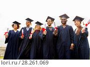 Купить «happy students in mortar boards with diplomas», фото № 28261069, снято 24 сентября 2016 г. (c) Syda Productions / Фотобанк Лори