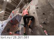 Купить «young woman exercising at indoor climbing gym», фото № 28261081, снято 2 марта 2017 г. (c) Syda Productions / Фотобанк Лори