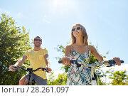 Купить «happy young couple riding bicycles in summer», фото № 28261097, снято 23 июля 2017 г. (c) Syda Productions / Фотобанк Лори