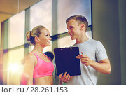Купить «smiling young woman with personal trainer in gym», фото № 28261153, снято 29 июня 2014 г. (c) Syda Productions / Фотобанк Лори